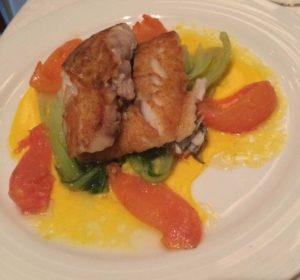 Hake fish with pak choi and tomatoes
